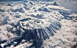 The age-old conflict is solved - experience breathtaking views of Mount Kilimanjaro from Kenya's Amboseli National Park and capture the greatest climbing moments from Tanzania's Kilimanjaro National Park.
